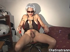 Nikki Nicole wearing a white wig while masturbating